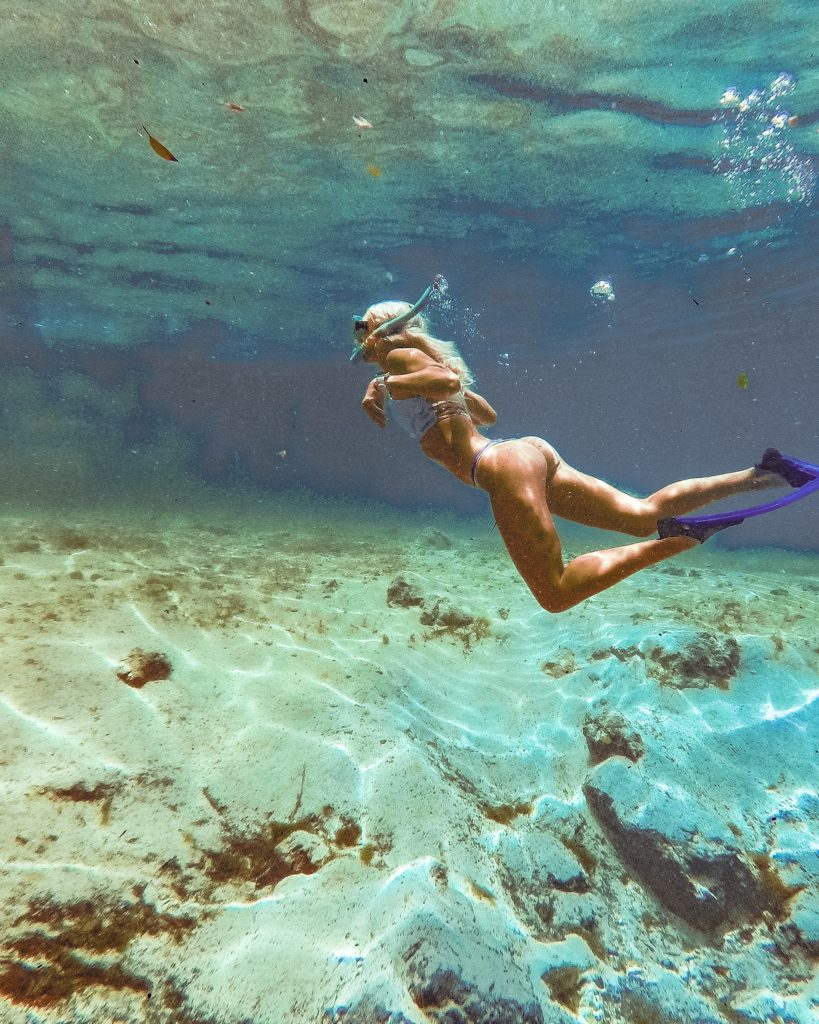 swimming underwater at three sister springs in Crystal River, Florida | guide to florida springs, where to go in florida, springs in florida, florida day trips